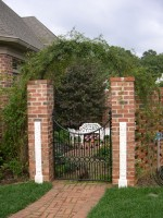 Fragment of Beijing fireplace surrounds on entrance to secret garden in North Carolina